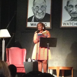 Naomi reading at Busboys and Poets, 2015